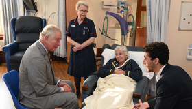 Patient Maria Brown, with son Joseph, meeting HRH alongside Ward Manager Sue Phillips.