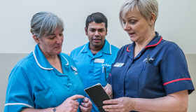 Dee View Court Nurses discuss a patient