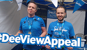 Two Great Aberdeen Runners with a Dee View Appeal sign