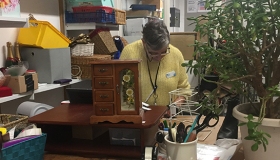 Volunteer Ann busily balancing the till at our Bury St Edmunds store.