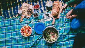A picnic blanket covered with lovely food
