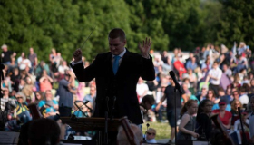 A conductor performing at proms in the park