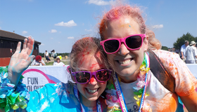 Mum and daughter celebrating the finish at Colour Rush