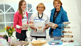 Leckhampton Court fundraisers and volunteers holding cakes