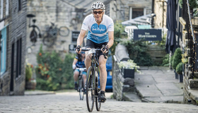 Male Bronte Sportive supporter in new branded Sue Ryder jersey