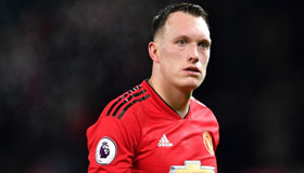 Footballer Phil Jones in Manchester United strip
