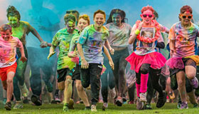 Runners covered in paint during the PaintRush fundraising event