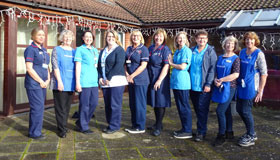 Sue Ryder Duchess of Kent Hospice Nurses standing outside the hospice together