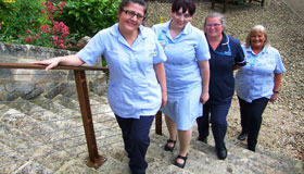 Sue Ryder Nurses Cath Shatford, Bex Pearce and Heather Mitchell standing on the hospice steps