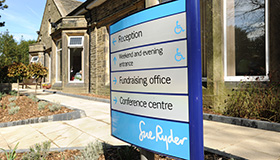 Image of Sue Ryder directions signage outside Sue Ryder Manorlands Hospice