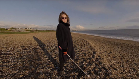 Image of Elizabeth, Sue Ryder case study for Right to Rehab campaign, on a beach
