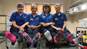 The lymphoedema team at Sue Ryder Duchess of Kent Hospice in their odd socks.