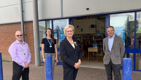 Image of Sue Ryder retail staff standing outside the Sue Ryder Kings Lynn furniture shop with the Deputy Lieutenant of Norfolk