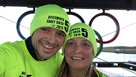 Jackie and Mark Smith in their bright green December Daily Dash clothing.
