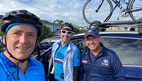 Russell and Rob in their cycling gear, on their 1,000 mile fundraising journey.