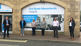 Sue Ryder Keighley shop staff with local MP Robbie Moore, outside the new charity shop