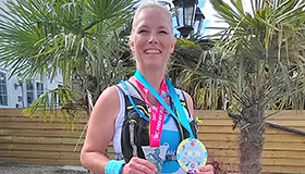 Kerry Surkitt with her medals, at her 50th marathon.