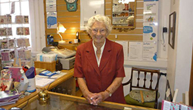 Renee Rowe at the counter in the Sue Ryder Cavendish shop