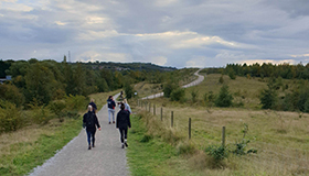 Walkers on a path through the countryside for Walk to Remember.