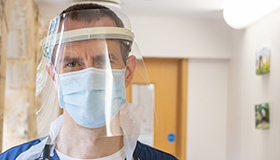 A Sue Ryder doctor wearing PPE