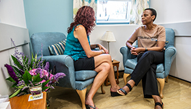 Two people talking during a counselling session