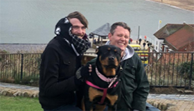 Lee Sharratt and his partner Marc, with their dog Rita.