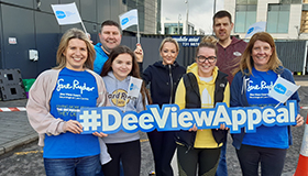 Wood employees holding the Dee View Appeal sign