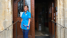 Sue Ryder Nurse, Georgie, pictured outside Sue Ryder Leckhampton Court Hospice